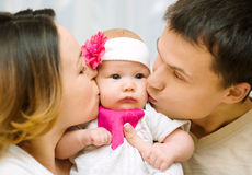 Parents kiss baby Royalty Free Stock Photos
