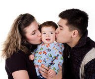 Parents kiss his son. White background Royalty Free Stock Photography