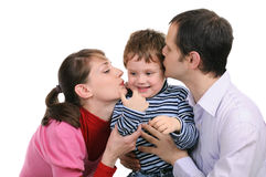 Parents kiss the small son Royalty Free Stock Photo