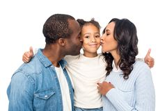 parents kissing adorable little daughter showing thumbs up stock image