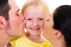 Parents kissing daughter. Parents kissing little daughter on white Royalty Free Stock Images