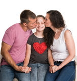 Parents kissing daughter Royalty Free Stock Photos