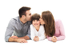 Parents kissing their son. Young family with son on white background Royalty Free Stock Image