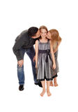 Parents kissing there daughter. stock image