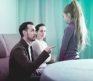 Parents lecturing daughter. Young parents lecturing their daughter for bad behavior at home Stock Photography