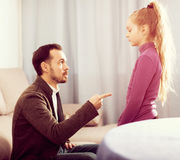 Parents lecturing daughter. Young parents lecturing their daughter for bad behavior at home Royalty Free Stock Photo