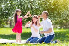 Little girl is playing with soap bubbles. stock photography
