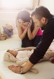 Parents with little baby at home Royalty Free Stock Photos