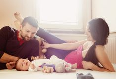 Parents with little baby at home Stock Photos