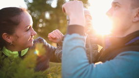 Parents with little baby standing in the park close-up stock footage