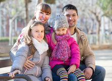 Parents with little daughters on bench Royalty Free Stock Photography