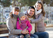 Parents with little daughters on bench Royalty Free Stock Image
