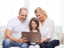 Parents and little girl with laptop at home Royalty Free Stock Photography