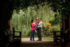 Parents and the little girl in summer garden Royalty Free Stock Photography