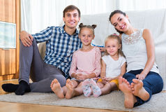 Parents with little girls indoors Royalty Free Stock Images