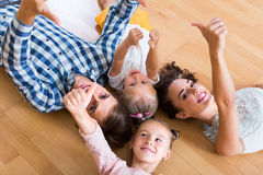 Parents with little girls indoors Stock Photo