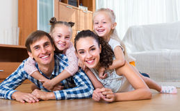 Parents with little girls indoors Royalty Free Stock Photography
