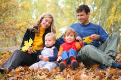 Parents look at children in autumn park Stock Images