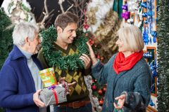 Parents Looking At Son With Wreath Around Neck In Stock Photography
