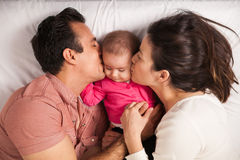 Parents in love with their baby girl Stock Photos