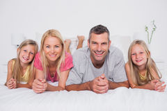 Parents lying in bed with their children Royalty Free Stock Photography