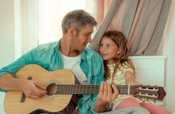 Happy family. Parents making music with child royalty free stock photos