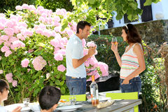 Parents making a toast outdoors Royalty Free Stock Photography