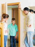 Parents meeting with scold of  son. In door at home Royalty Free Stock Images