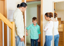 Parents meeting with scold of  son. In doorway at home Royalty Free Stock Image
