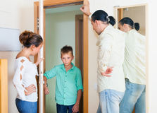 Parents meeting with scold of teenage son. In door at home Royalty Free Stock Images