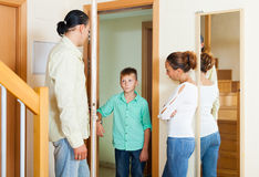 Parents meeting with scold of teenage son. In the doorway at home Royalty Free Stock Images