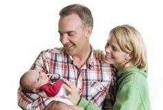 Parents neufs avec leur bébé Photo stock