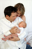 Parents with newborn baby. Happy parents looking over thier newborn baby Stock Image