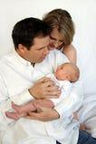 Parents with newborn baby stock image