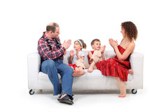 Parents play with children white leather sofa Stock Image
