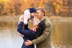Parents play with little daughter Stock Photos