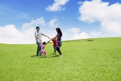 Parents play with their children in park Royalty Free Stock Images