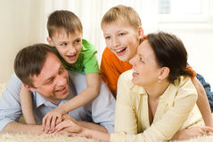 Parents play with their sons Royalty Free Stock Photo