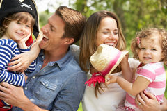 Parents Playing Adventure Game With Children. Parents Playing Exciting Adventure Game With Children In Summer Field Royalty Free Stock Image