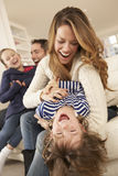 Parents playing with children at home royalty free stock photos