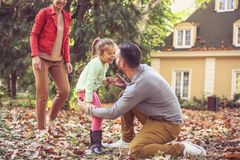 Parents playing with daughter. On the move. stock photos