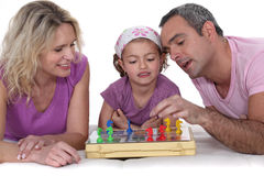 Parents playing with daughter Stock Image