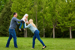 Parents playing exciting  with child In the park.Happy family. Royalty Free Stock Images