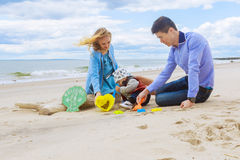 Parents playing with his son on the beach Royalty Free Stock Image