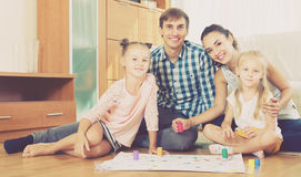 Parents playing with kids at home Royalty Free Stock Image