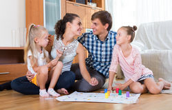 Parents playing with kids at home Royalty Free Stock Photos