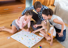Parents playing with kids at home Stock Images