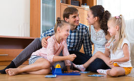Parents playing lotto with kids Stock Image