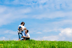 Parents playing with offspring. Young cheerful parents playing with their offspring Stock Photos