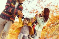 Parents playing with their child royalty free stock photo